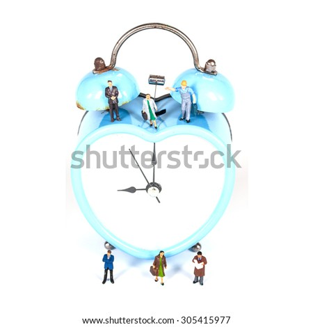 selective focus of miniature people on blue old retro clock on white background ,abstract background to time management. - stock photo