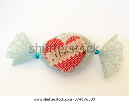 """selective focus of pillow heart candy with the word """"I love you"""" isolated on white background, gift of special days such as Valentine's day. - stock photo"""