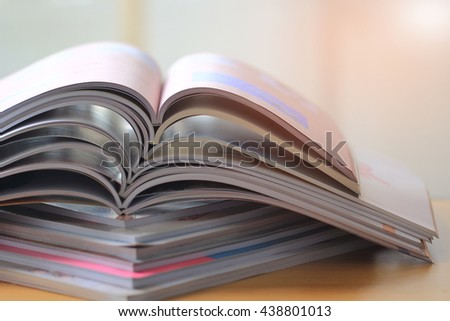 selective focus of the stacking magazine place on table. - stock photo