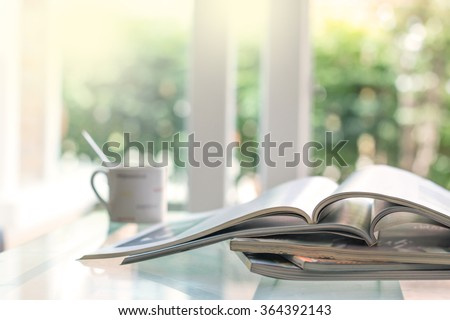 selective focus of the stacking magazine place on table in living room - stock photo