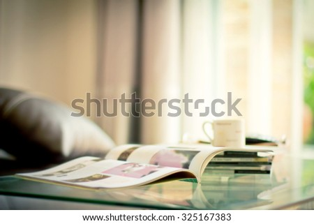 selective focus of the stacking magazine place on table in living room , extremely shallow DOF - stock photo