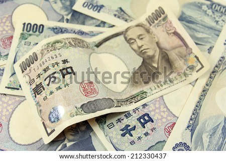 selective focus on heap of japanese yen banknotes - stock photo