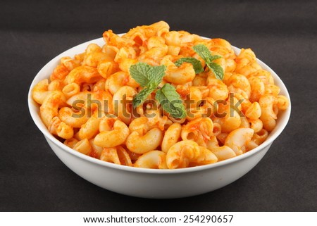 Selective focus on Pasta with tomato  and herbs . - stock photo