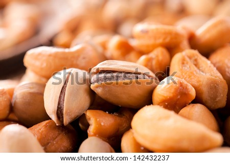 Selective focus on pistachio on the top - stock photo
