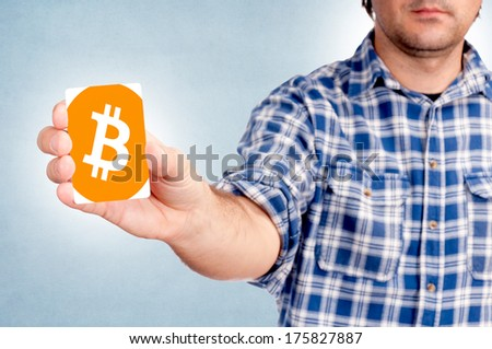 Selective focus on the bitcoin card in mans hand - stock photo
