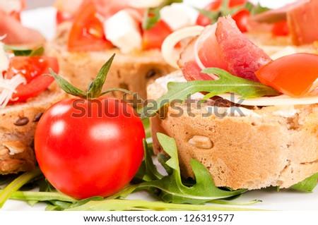 Selective focus on the cherry tomato - stock photo