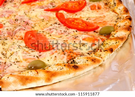 Selective focus on the first piace of the pizza - stock photo