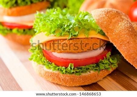 Selective focus on the fish burger on the top  - stock photo