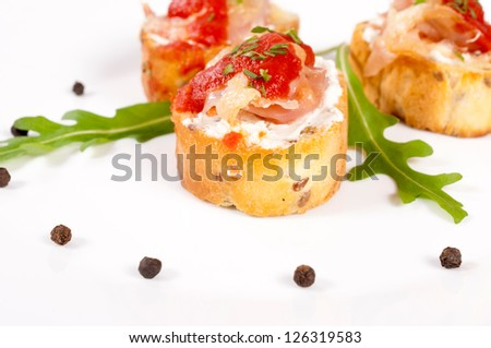 Selective focus on the front bruschetta bread - stock photo