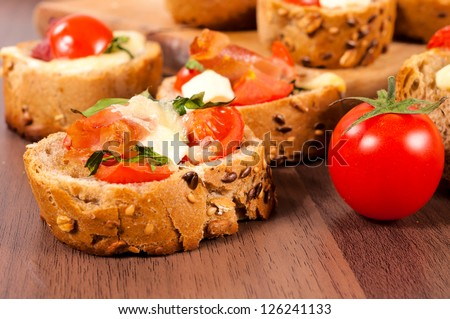 Selective focus on the front bruschetta sandwich - stock photo