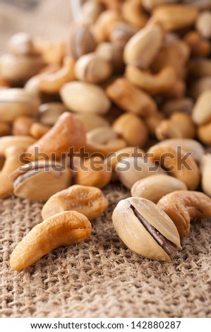 Selective focus on the front cashew nut and pistachio - stock photo