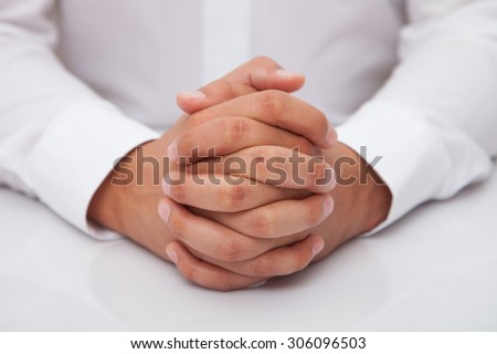 Selective focus on the front fingers on male hands - stock photo