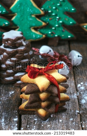 Selective focus on the front gift gingerbread cookies on wooden background  - stock photo