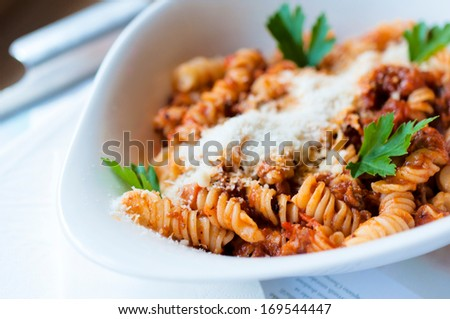 Selective focus on the front pasta bolognese - stock photo