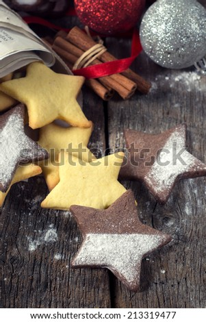 Selective focus on the front star shape gingerbread Christmas cookie on wooden background  - stock photo