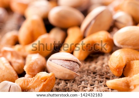 Selective focus on the single front pistachio - stock photo