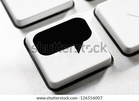 Selective focus on the speech button - stock photo