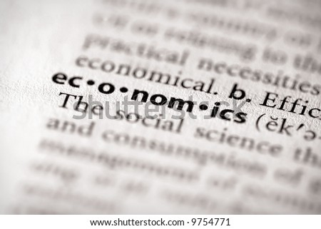 """Selective focus on the word """"economics"""". Many more word photos for you in my portfolio... - stock photo"""