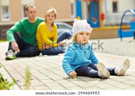 selective focus. outdoor portrait of a family. young parents with a baby for a walk in the summer. Mom, dad and child - stock photo