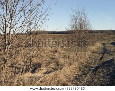 Selective focus shot of rural landscape at early spring or late autumn - stock photo