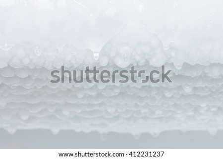 selective focus Water dripping from ice refrigerator freezer - stock photo