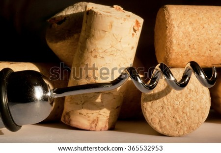 Selective focus wine corkscrew and many corks on a bar table - stock photo