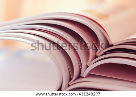 selective soft focus of open and Stacking of magazines, vintage and retro style - stock photo
