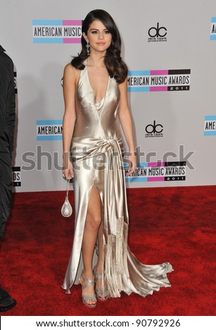 Selena Gomez arriving at the 2011 American Music Awards at the Nokia Theatre, L.A. Live in downtown Los Angeles. November 20, 2011  Los Angeles, CA Picture: Paul Smith / Featureflash - stock photo
