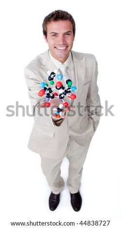 Self-assured businessman holding a molecule against a white background - stock photo