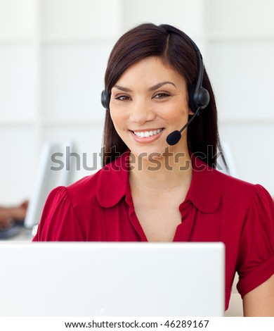 Self-assured Customer service representative using headset in the office - stock photo