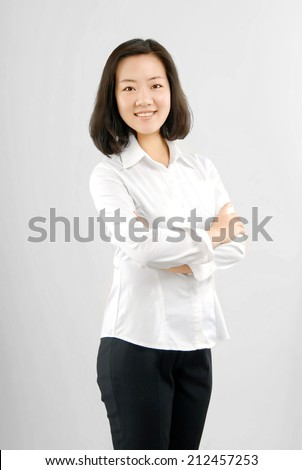 Self-confidence mature career women.Standing in front of a white background. - stock photo