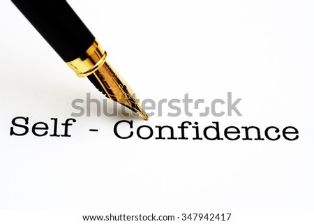 Self confidence text and fountain pen - stock photo