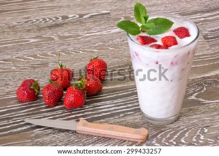 Self-made strawberry milkshake with fresh fruits - stock photo
