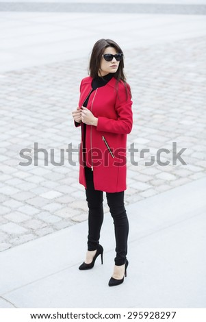 Self-made woman posing in a stylish outfit - stock photo