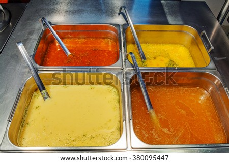 Self service restaurant with a variety of soups  - stock photo