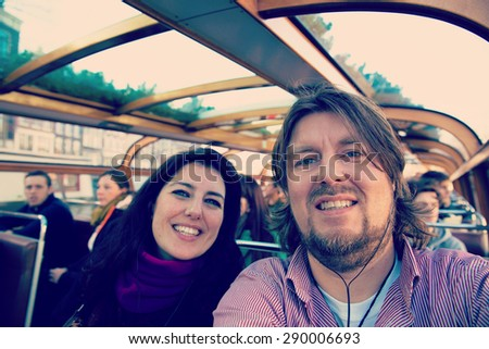 Selfie of happy couple on holidays in Amsterdam with filters applied for hipster look - stock photo