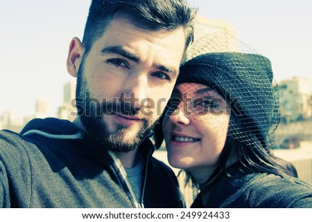 selfie portrait of young couple outdoors - stock photo