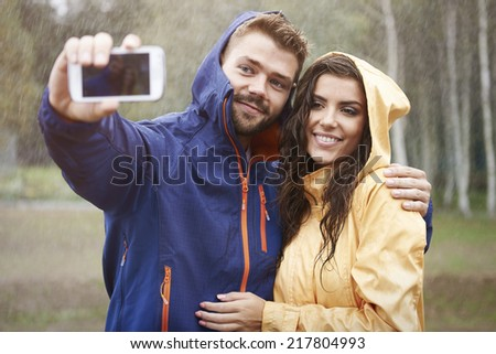 Selfie with my beautiful girlfriend in rainy day  - stock photo