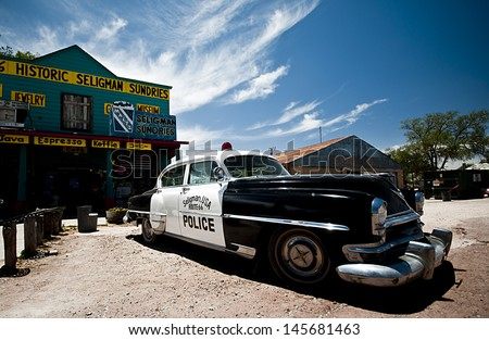 SELIGMAN, USA - June 8: Famous stop of the Route 66 on June 8, 2013 in Seligman. Famous as origin of historic Route 66 and inspiration for the town of Radiator Springs in the Pixar movie Cars - stock photo