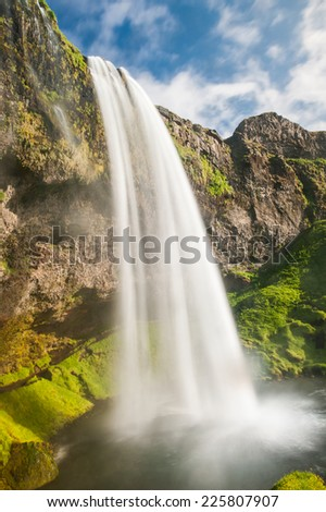 Seljalandsfoss is one of the most beautiful waterfalls on the Iceland. It is located on the South of the island.  - stock photo