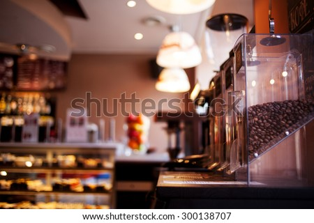 sell whole bean coffee in a cafe, close-up, soft focus - stock photo