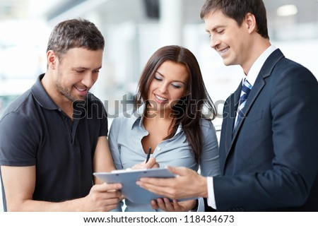 Seller and buyer in the showroom - stock photo