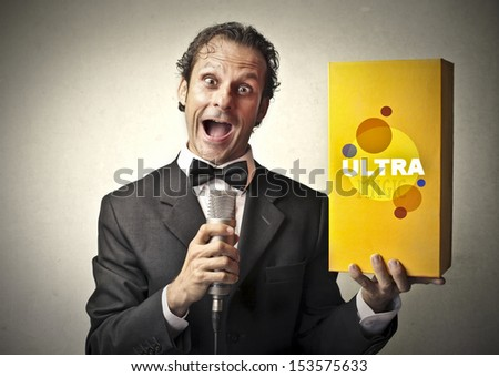 seller promotes a product speaking with the microphone - stock photo