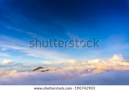 semeru mount over the cloud and blue sky - stock photo