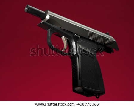 semi-automatic hand gun on red background, unloaded position - stock photo
