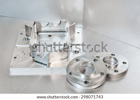 Semi-finished steel blank and flanges. Mechanical engineering. Milling and lathe industry. CNC technology. - stock photo