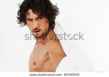 semi nude portraits of a handsome muscular man isolated on white in studio - stock photo