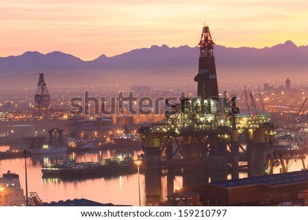 Semi Submersible drilling rig in the middle of the shipyard in town - stock photo