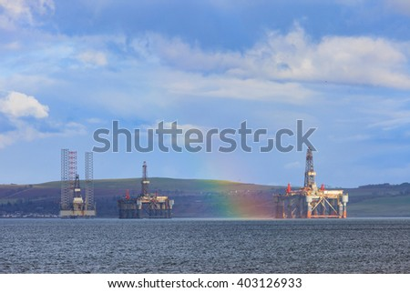 Semi Submersible Oil Rig with rainbow after Raining at Cromarty Firth in Invergordon, Scotland - stock photo