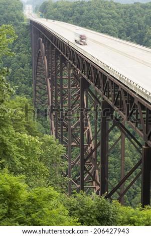 Semi Truck In Motion On New River Bridge - stock photo